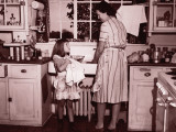 Mother and Daughter (8-10) Washing and Wiping Dishes