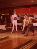1960's Era Couple Bowling in Tenpin Bowling Alley