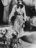 Woman With Two Dalmatians Wearing Patterned Dress