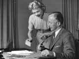 Woman Showing Man Cheque  Man Holding Pen