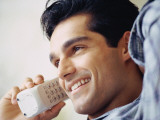 Man Talking on Cordless Phone