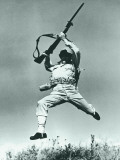 Soldier Jumping With Rifle  Low Angle View