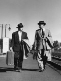 Two Men Walking  Carrying Luggage  Briefcase and Coats