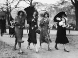 Group of Women Walking With Umbrellas  Circa 1930's