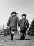 Boy and Girl Holding Hands  Walking To School