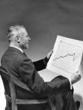 Man Looking at Chart