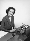 Woman Typing  Posing and Smiling