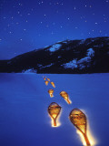 Snowshoes Lighted By Flashlight Across Lake Mcdonald  Glacier National Park  Montana  USA