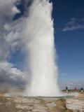 Tourists Watch Strokkur Geyser Erupting  Geysir  Iceland