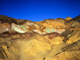 Artists Palatte a Rainbow of Colors at Edge of Black Mountains  Death Valley National Park  CA