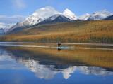 Sea Kayaker on Bowman Lake in Autumn in Glacier National Park  Montana  USA