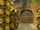 Oak Barrels Stacked Outside of Door at Ironstone Winery  Calaveras County  California  USA