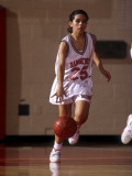 High School Girls Basketball Player in Action