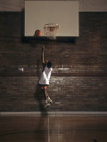 Young Boy Practicing his Basketball Shooting