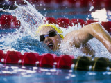 Female Swimmer Competing in a Race