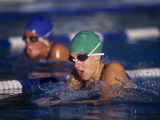 Female Swimmers Competing in a Breaststroke Race