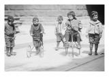 Children With Tricycles Playing In Manhattan Street