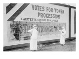"Suffragettes Uses Long Brushes To Post a Billboard Announcing a ""Votes"" For Women"" Parade"