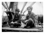 Two Sikh Men Sitting on a Dock  Circa 1913