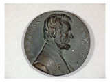 Medallion Made of Plaster Depicts Abraham Lincoln in Low Relief