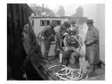 Inspecting the Piles at Tacoma  Diver on Deck in Suit  1924