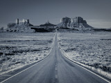 Straight Road Cutting Through Landscape of Monument Valley  Utah  USA