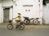Woman Riding Bicycle Along Street  Ben Tre  Vietnam