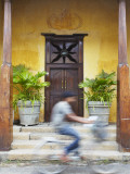 Man Cycling Past Doorway in Old Town of Galle Fort  Galle  Sri Lanka