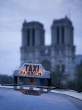 Notre Dame Cathedral and Taxi  Paris  France