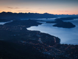 High Angle View of a Coastal Town Lit Up at Dusk  Lake Nahuel Huapi  San Carlos De Bariloche