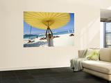 Man Putting Up Umbrella on Kamala Beach
