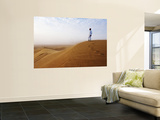 Man Standing on Sand Dune Looking Out on Arabian Desert