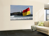 Lifeguards&#39; Warning Flag and Godrevy Lighthouse