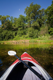 Kayak on a Forested Lake