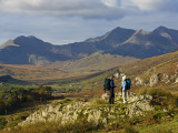 North Wales  Snowdonia; a Man and Woman Stop to Look at their Map Whilst Hiking in Snowdonia;