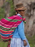 Peru; an Indian Woman Wearing Carries Her Farm Produce to Market in a Brightly Coloured Blanket