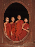 Myanmar  Burma  Nyaungshwe; Young Novice Monks Standing at a Wooden Oval Window