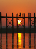Myanmar (Burma)  Amarapura  Taungthaman Lake  U Bein's Bridge  a Monk Walking Home at Sunset