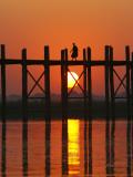 Myanmar (Burma)  Amarapura  Taungthaman Lake  U Bein's Bridge  a Monk Walking Home at Sunset