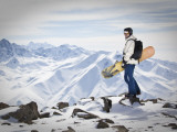 A Snowboarder at the Summit of Mount Affawat in Gulmarg  Kashmir  India