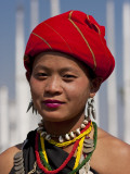 Myanmar  Burma  Loikaw; a Kayah Girl in Front of Ceremonial Posts at Chitkel Village