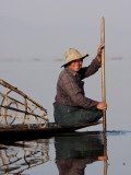 Myanmar  Inle Lake; Intha Fisherman Gently Paddling His Boat across Inle Lake  Myanmar