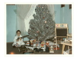 Boy with Gun and Fake Christmas Tree
