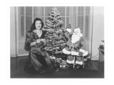 Woman at Christmas Tree with Cut-Out Santa