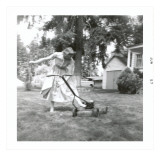Woman in Dress Starting Lawn Mower