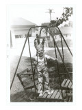 Boy with Indian Headdress on Swing Set