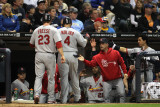 Cardinals v Brewers - Milwaukee  WI - Oct 16: David Freese  Yadier Molina and Rafael Furcal