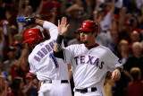 Detroit Tigers v Texas Rangers - Game Six  Arlington  TX - Oct 15: Josh Hamilton and Elvis Andrus