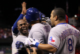 Rangers v Cardinals  St Louis  MO - Oct 27: Nelson Cruz  Esteban German and Yorvit Torrealba