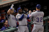 Rangers v Cardinals  St Louis  MO - Oct 27: Josh Hamilton  Esteban German and Yorvit Torrealba